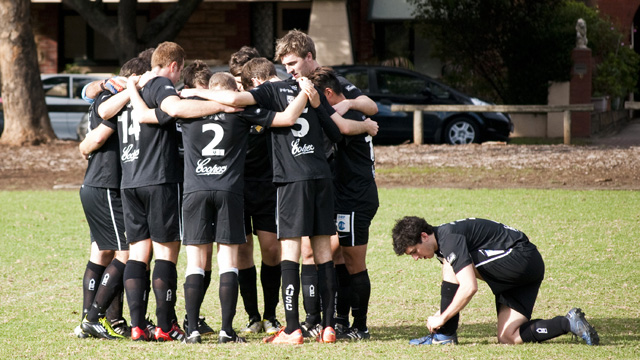 Blacks Premier Men huddle